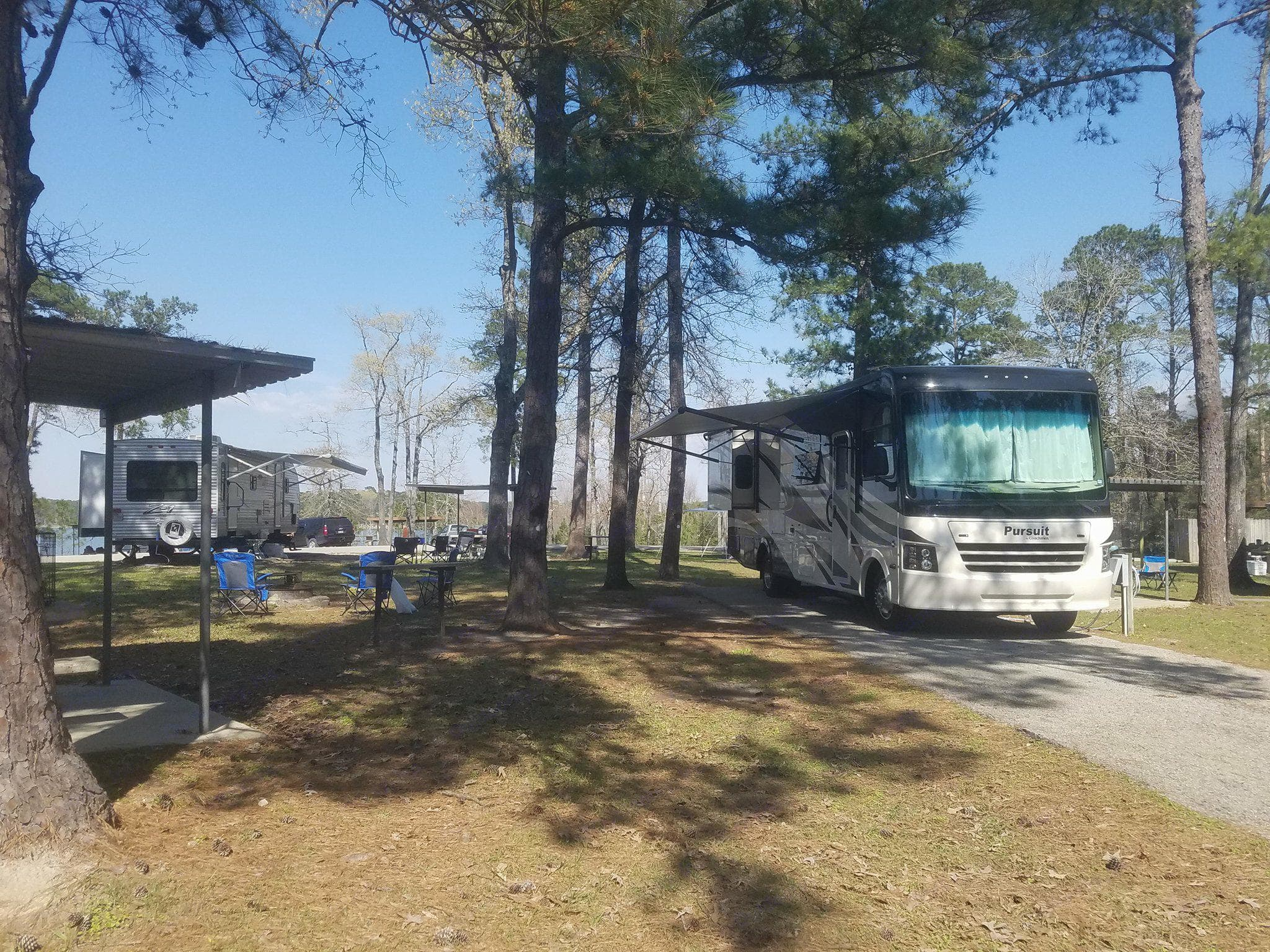 Exterior with awning out.. Coachmen Pursuit 2017