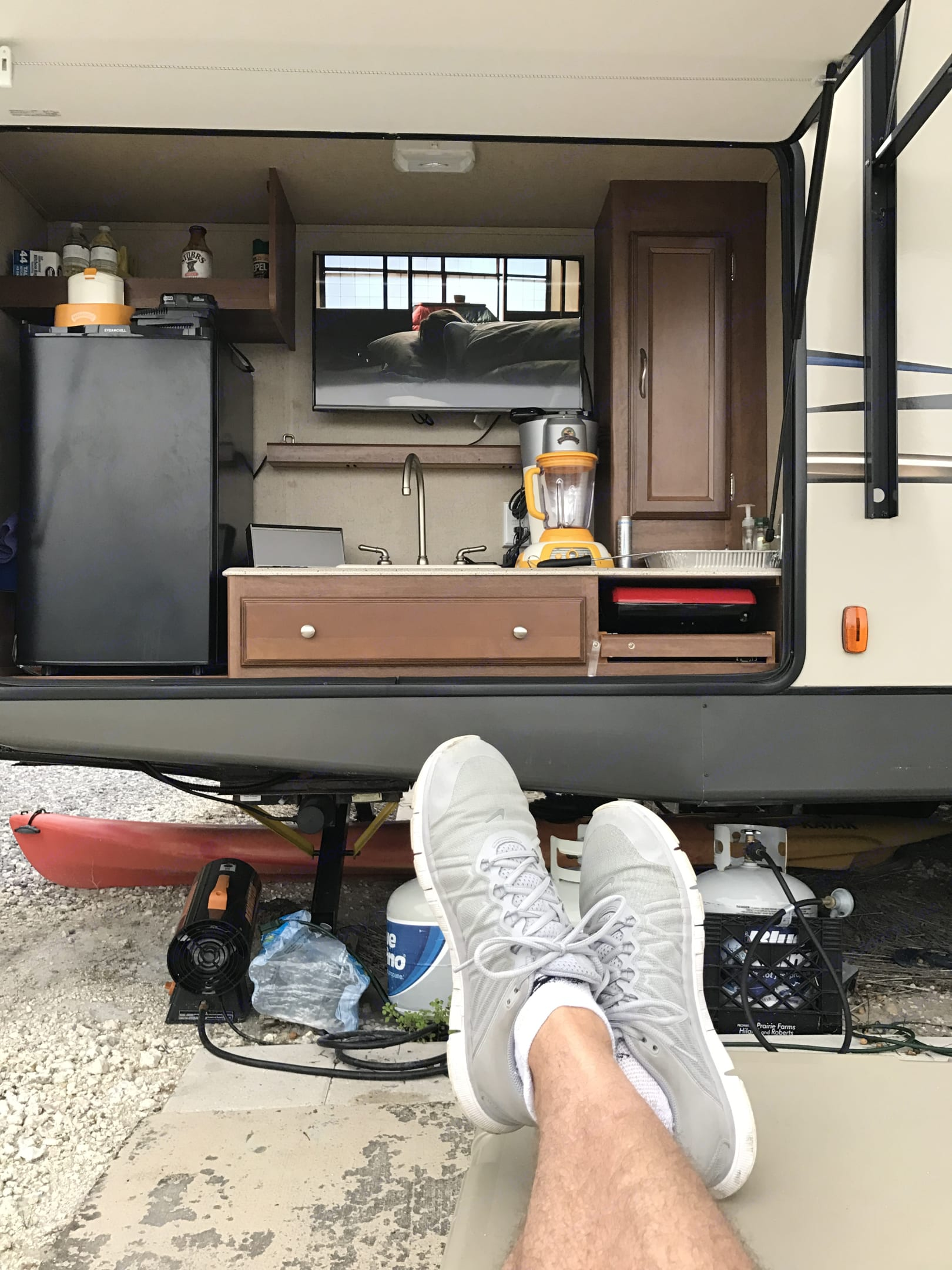 """Outdoor Kitchen with mini-fridge, 32"""" Samsung LED TV, Coleman grill and Margaritaville cordless blender. Coachmen Freedom Express 2016"""