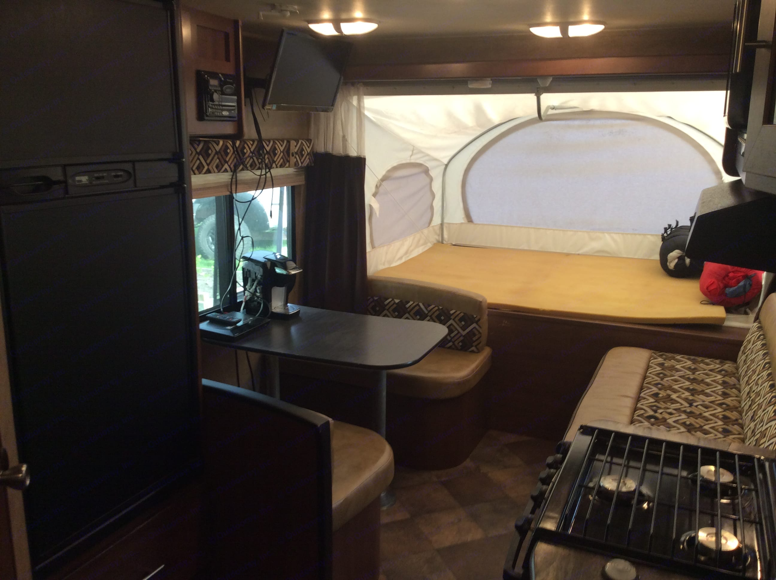 Dining area, couch, TV, DVD, Stereo system and another queen size bed. (Mattress not shown). Dutchmen Aerolite 2013