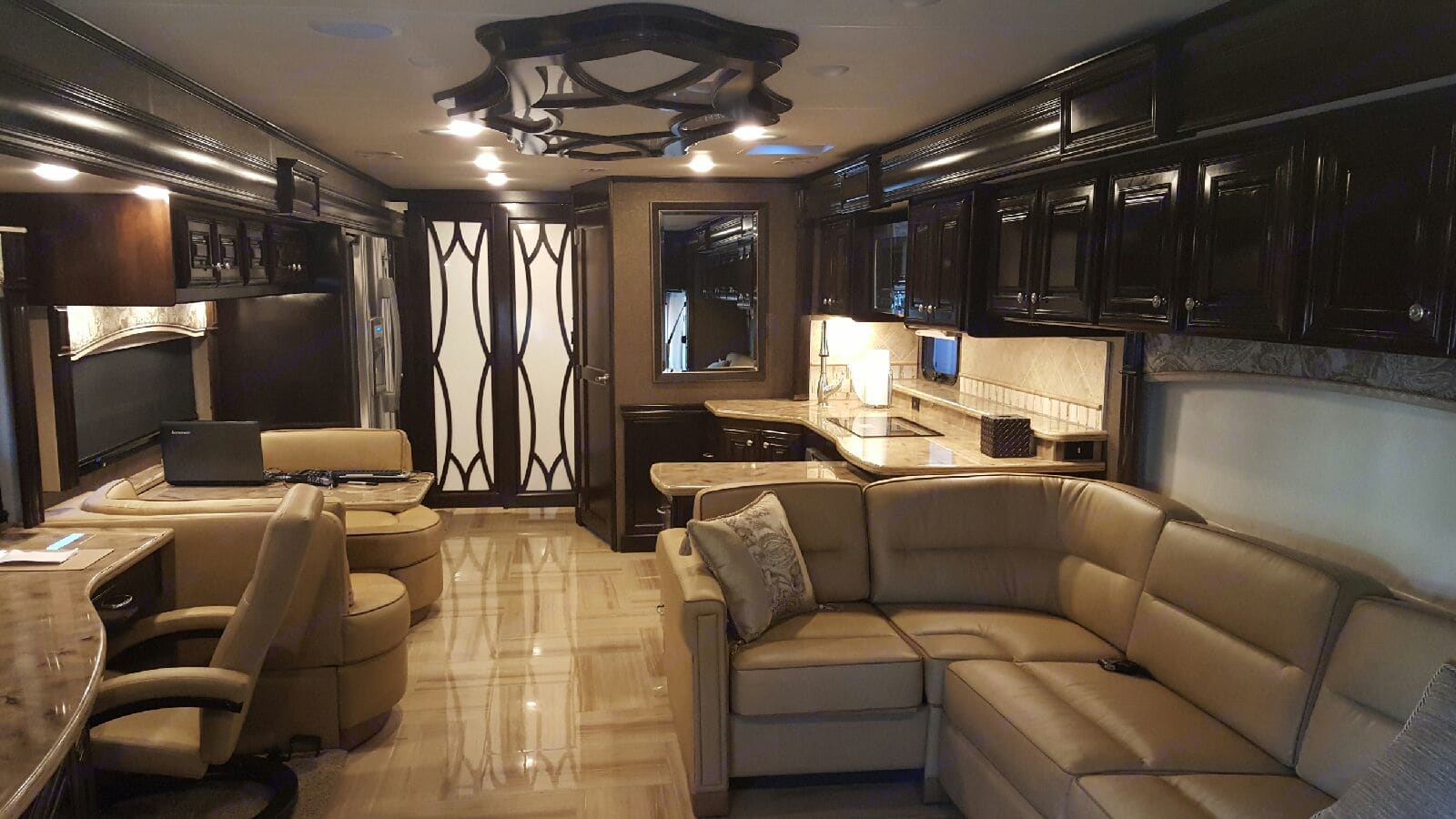 Front lounge and kitchen area view from driver area. Thor Motor Coach Tuscany 2016