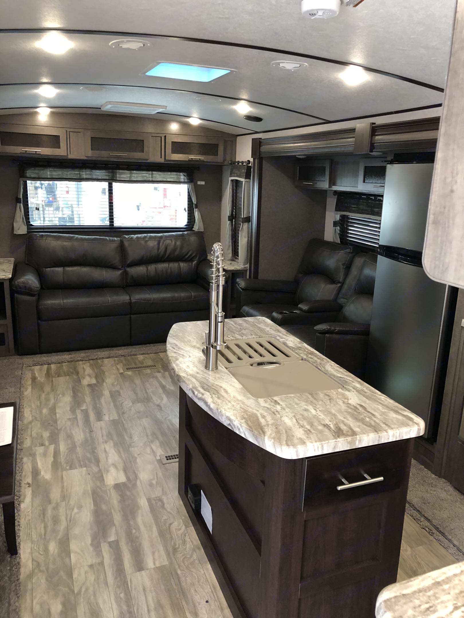 With two living are slide outs, the living area is very comfortable and spacious. The couch makes into a queen bed. Theatre seating to watch TV in complete comfort. . Forest River Surveyor 2019