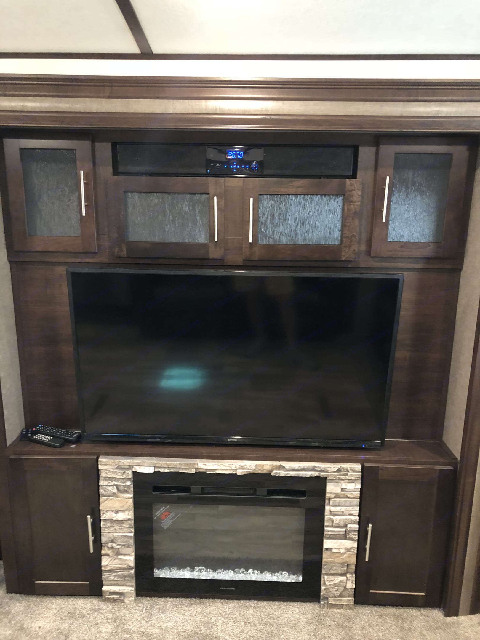"""Nice 46"""" inch TV in the living room above the fireplace. . Forest River Surveyor 2019"""