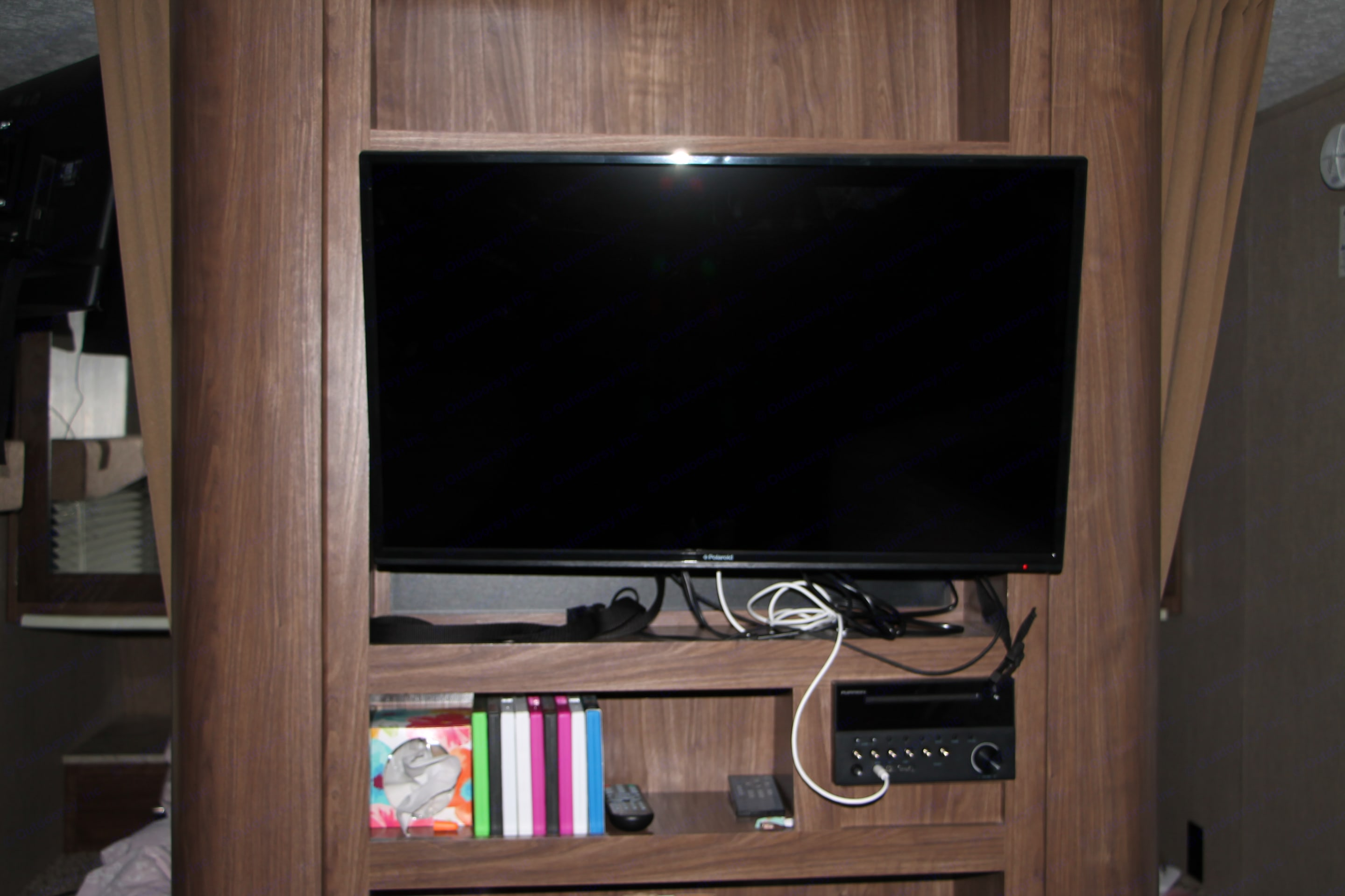 32 in TV connected to the entertainment area. It is connected to the trailer speakers, and DVD player. We can also let you borrow tons of kids DVDs on request for no additional charge!. Coleman Other 2018