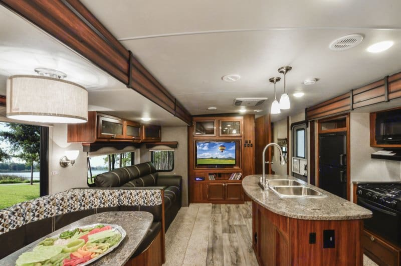 Plenty of living space.  Couch can convert to sleeper for 2.  Dining can convert to sleeper for 2 as well.  The TV is included.....AND it swivels to watch in master bedroom.. Heartland Mallard 2019