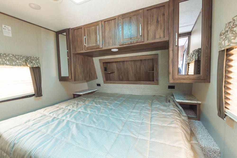 Large Master Bedroom with KING SIZED bed, walk around space, and plenty of storage.. Keystone Cougar Half-Ton 2018
