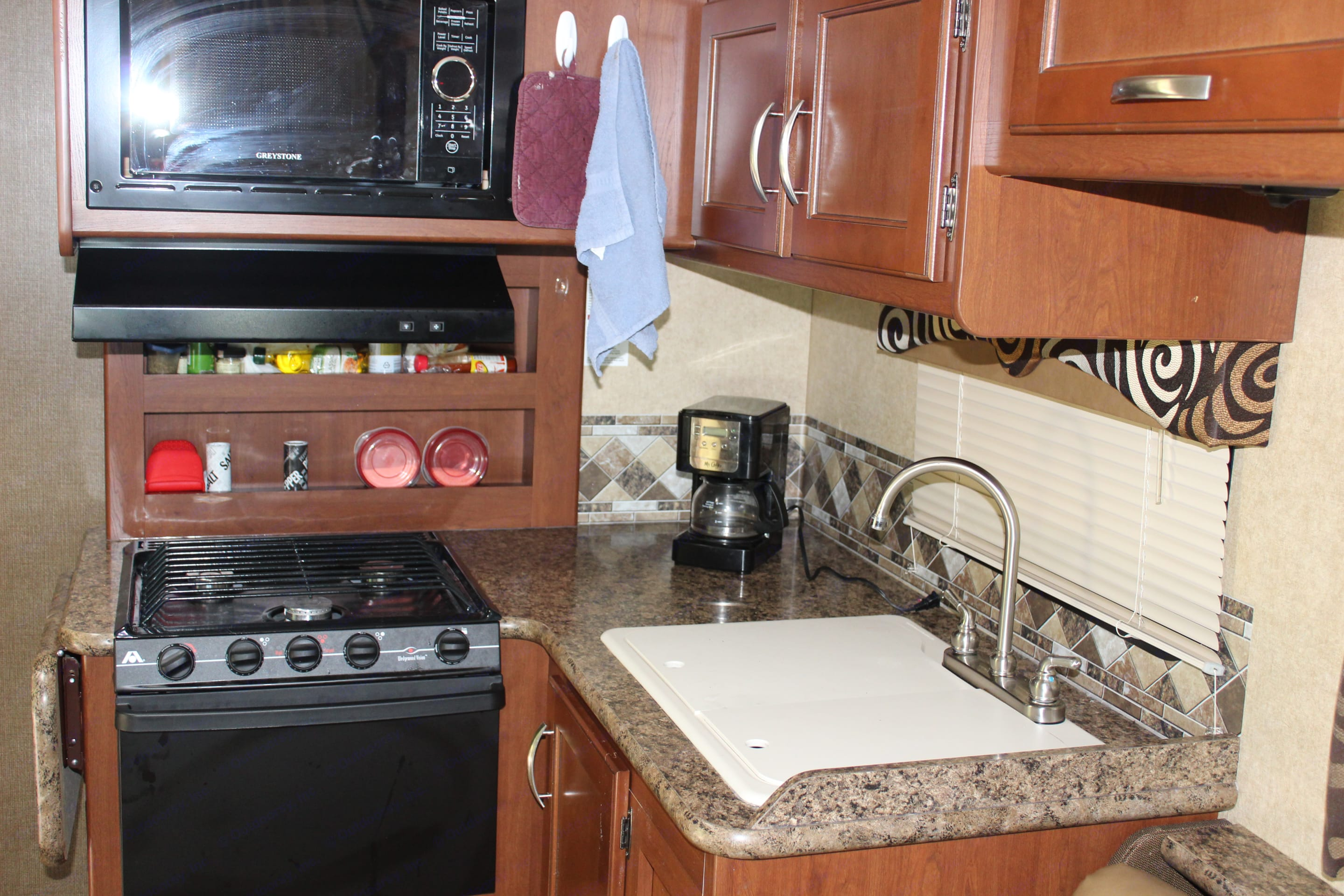 Kitchen area. The kitchen is fully equiped with melamine dinnerware set for 4, silverware and cookware.  Although if you are like us, we use a lot of paper plates when we camp!. Thor Motor Coach Freedom Elite 2017