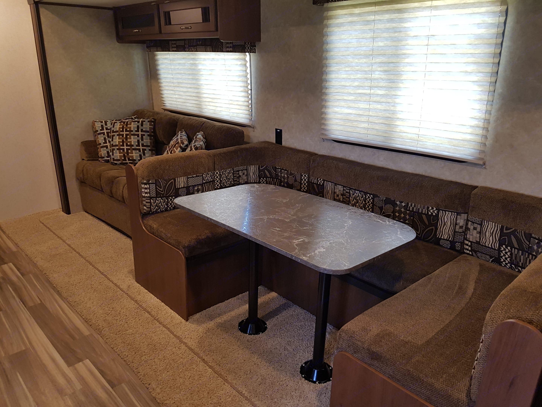 Large U shape dinette in large size living room. Jayco Jay Flight Swift 2017