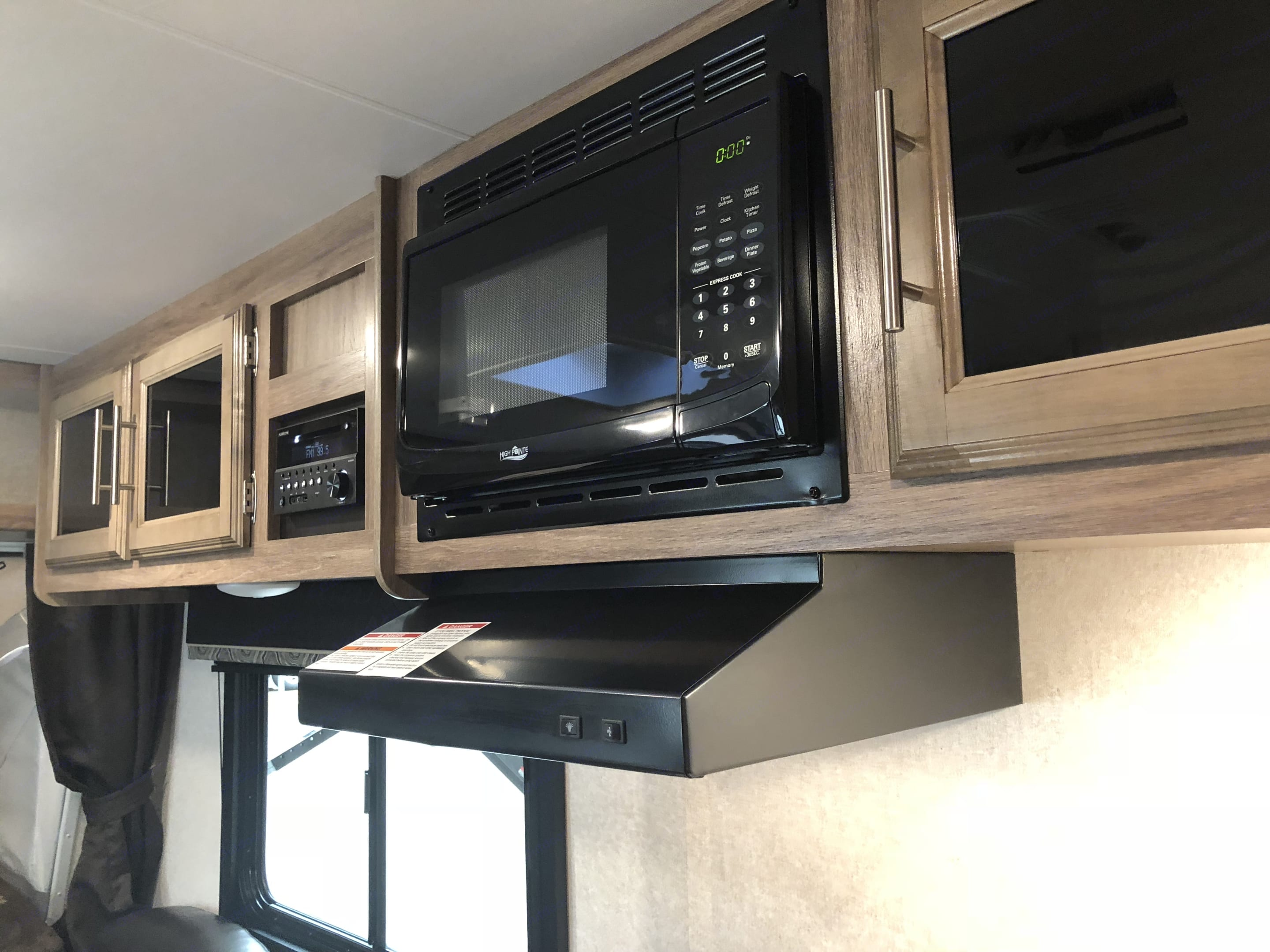 Storage, microwave, hooded range with a fan and light, radio with indoor/outdoor speakers, blue tooth capabilities, dvd player which plays to the television.. Jayco Jay Feather 2018