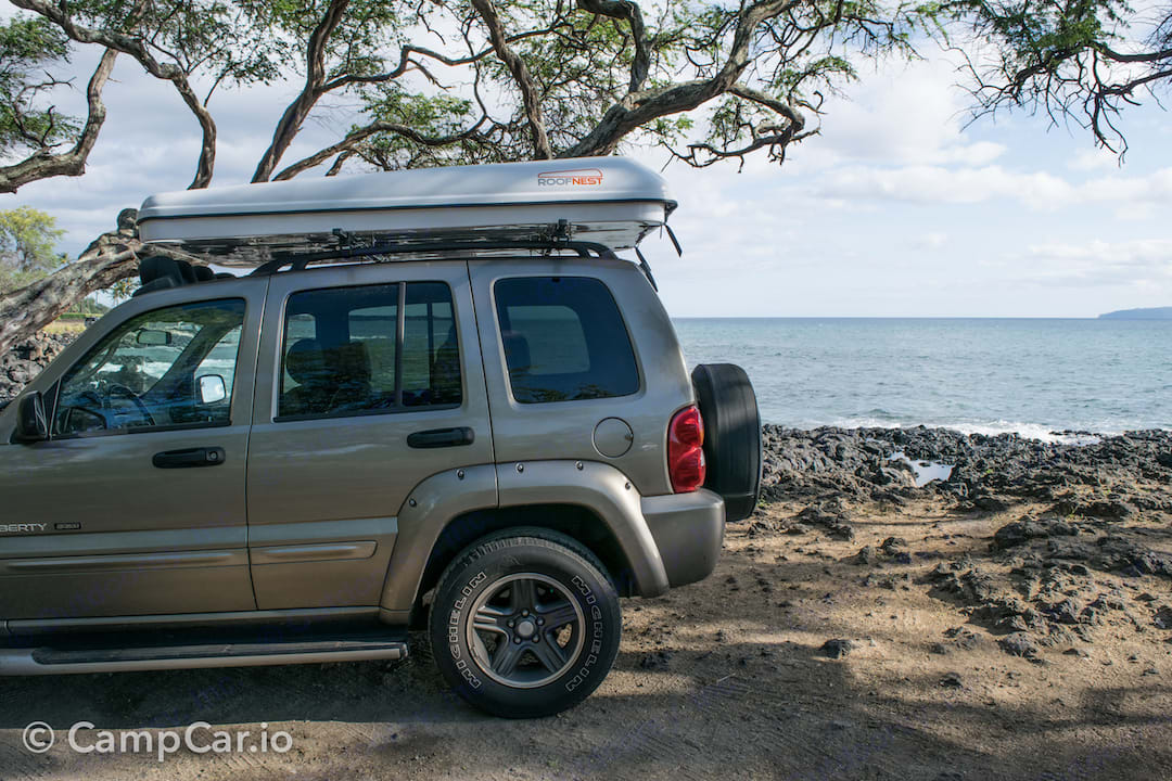 Arrive at the beach ready to camp with rooftop tent ready to go!. Jeep Liberty Renagade 2003