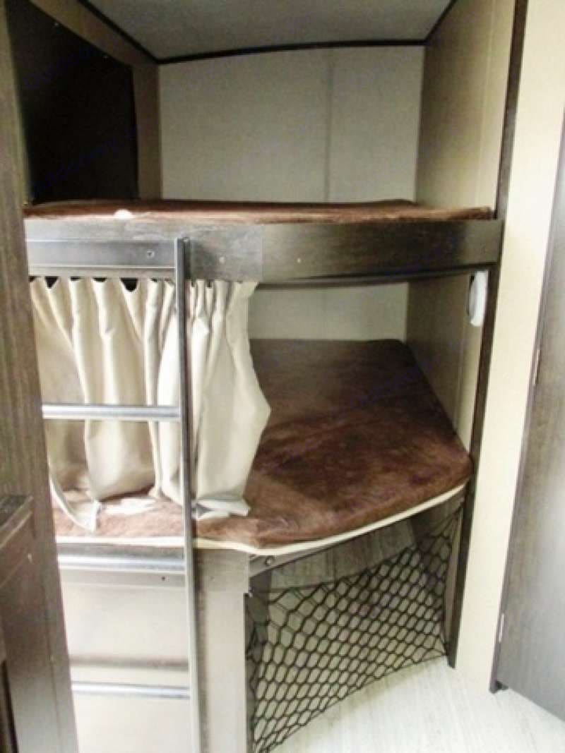 Double bunks with lots of storage underneath for coolers and such.. Grand Design Imagine 2016