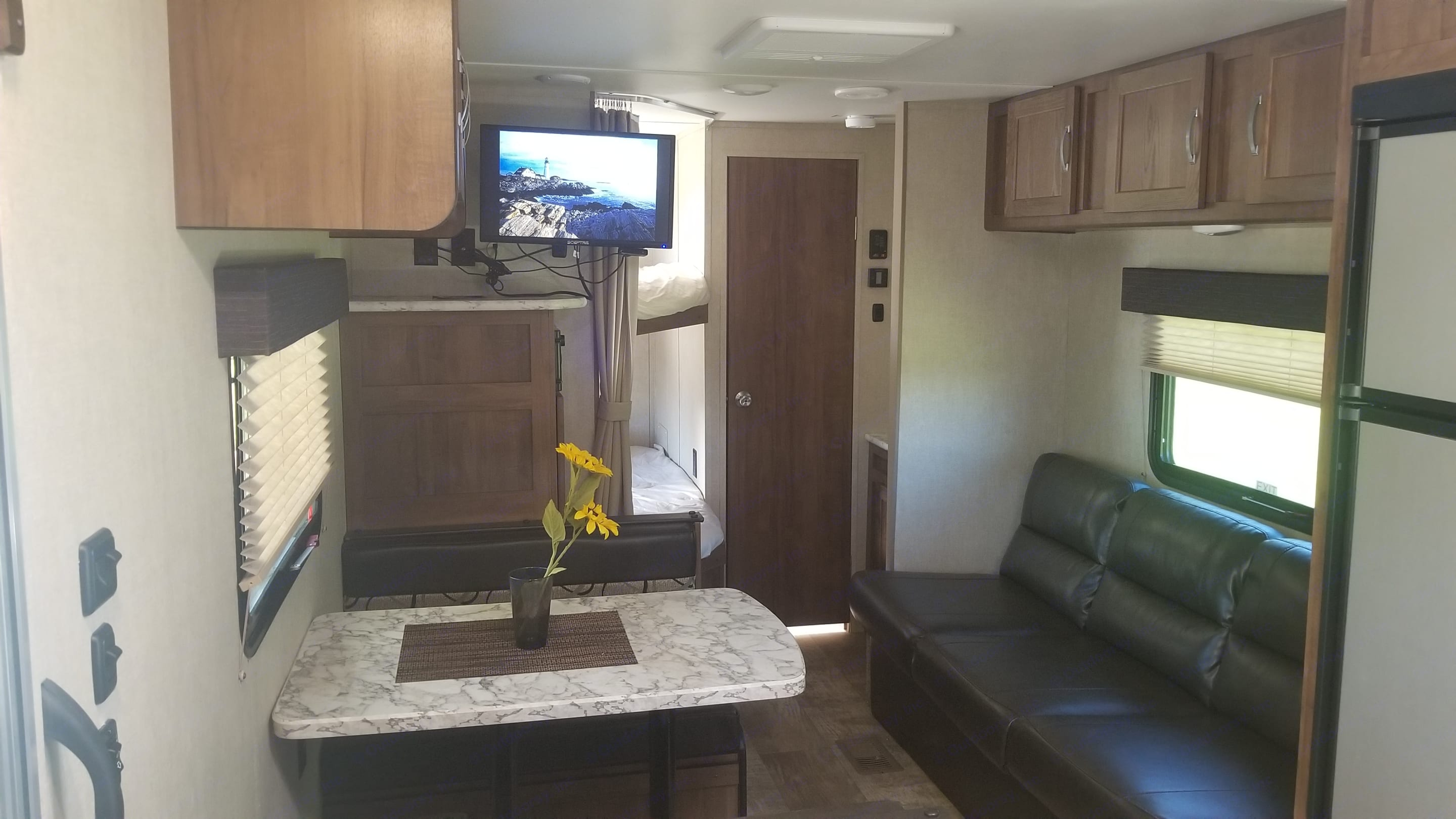 Dining and entertainment area with TV with DVD and Roku. Gulf Stream Innsbruck 2019
