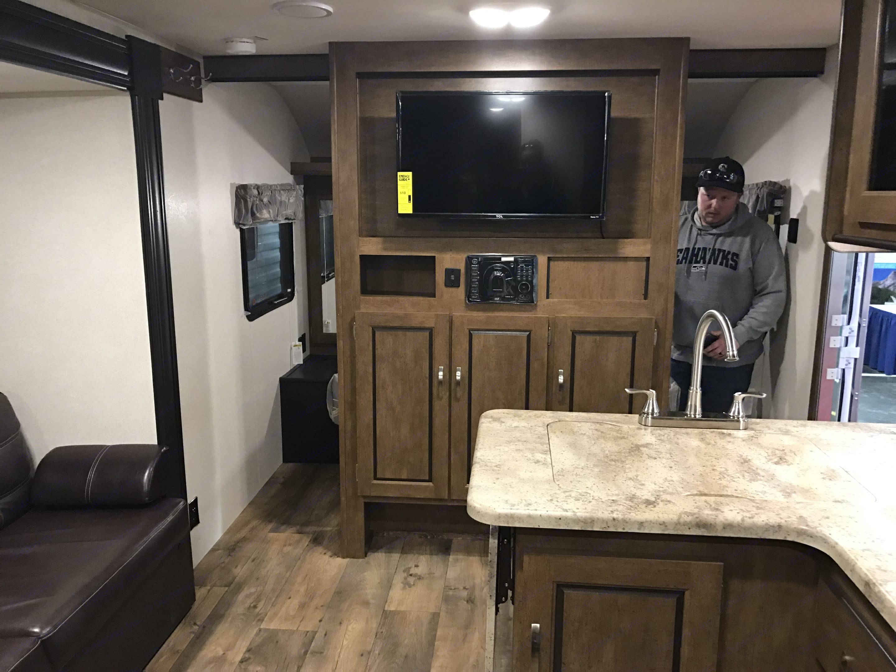 entertainment center divides bedroom from the rest of the space. comes with some family friendly movies and games.. Forest River Wildwood X-Lite 2018