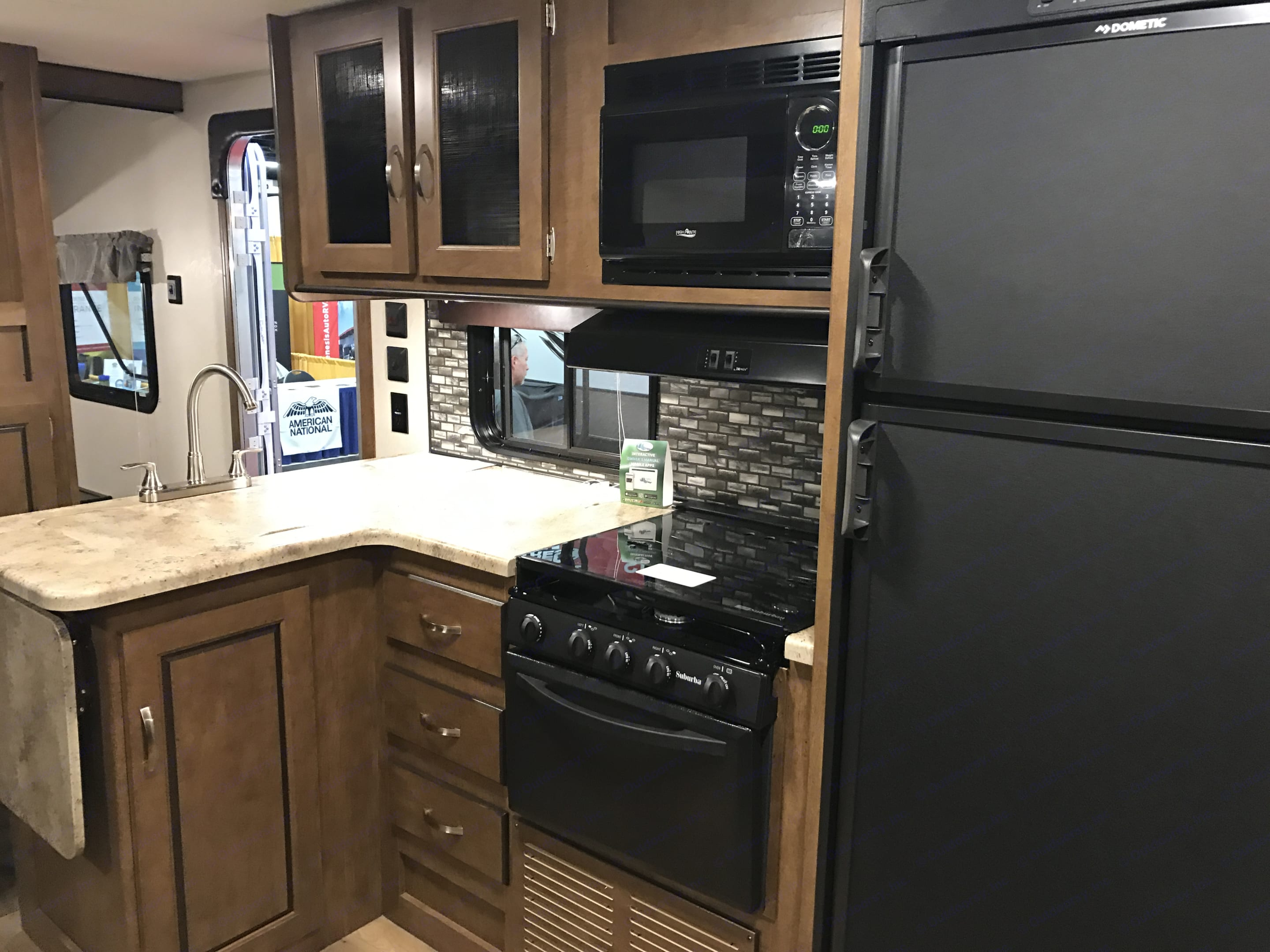 kitchen with plenty of prep and cooking space. comes with all dishes, pots and pans, silverware, linens and coffee pot.. Forest River Wildwood X-Lite 2018