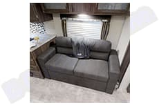couch that turns into a bed . Coachmen Apex 2019