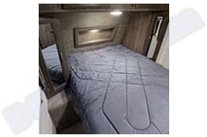 master bed in its separate room with turning TV.. Coachmen Apex 2019