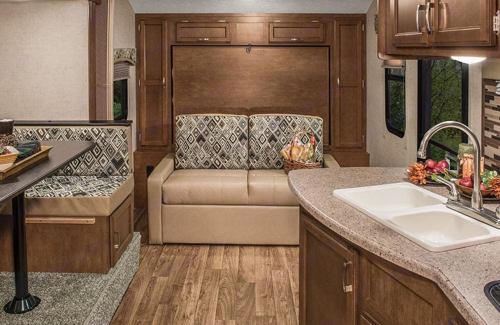 Murphy bed folds down to make a queen bed.. Venture Rv Sonic 2016