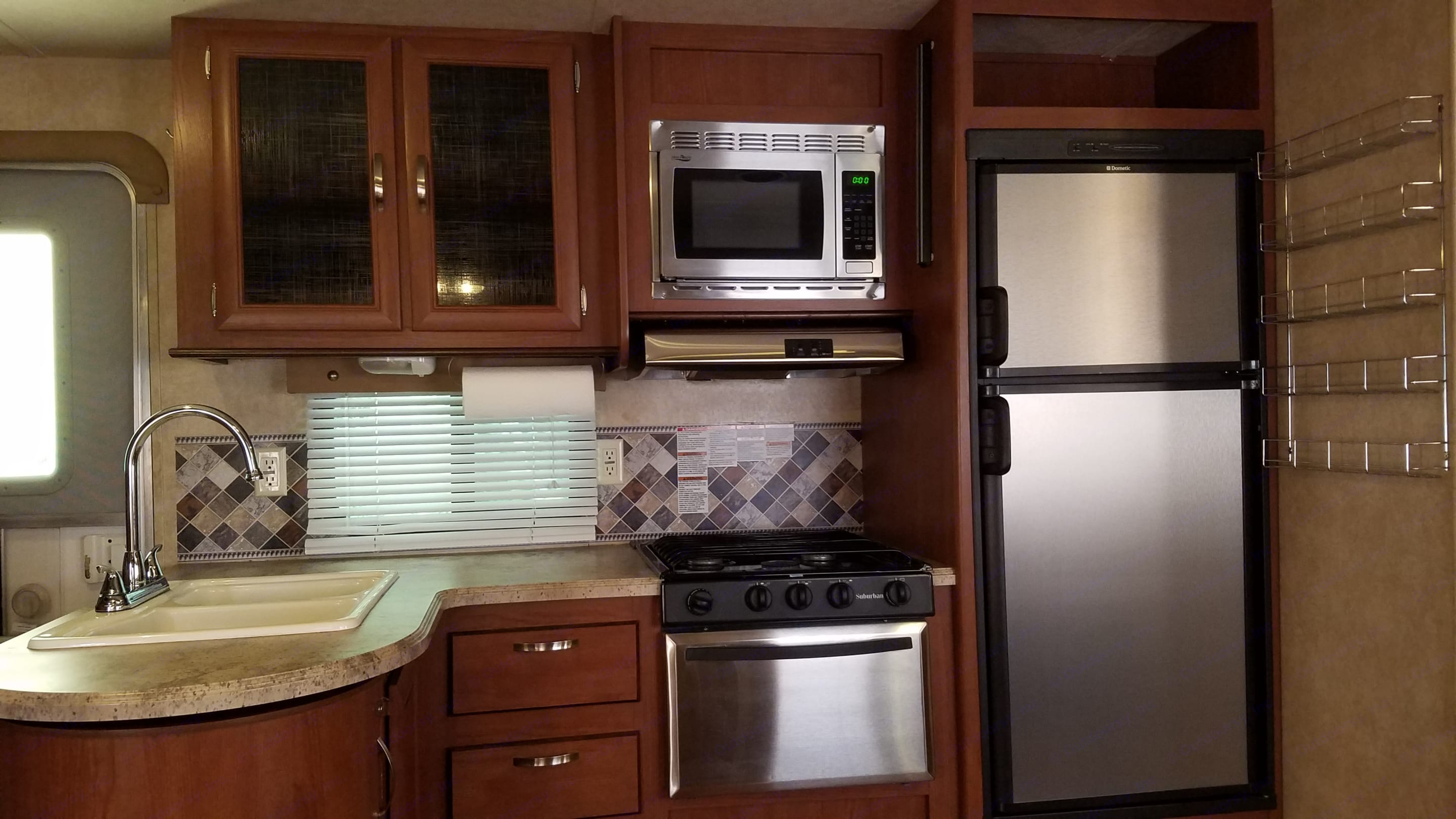 Fully stocked kitchen! Plates, bowls, cups, utensils and so much more!. Forest River Wildwood 2016