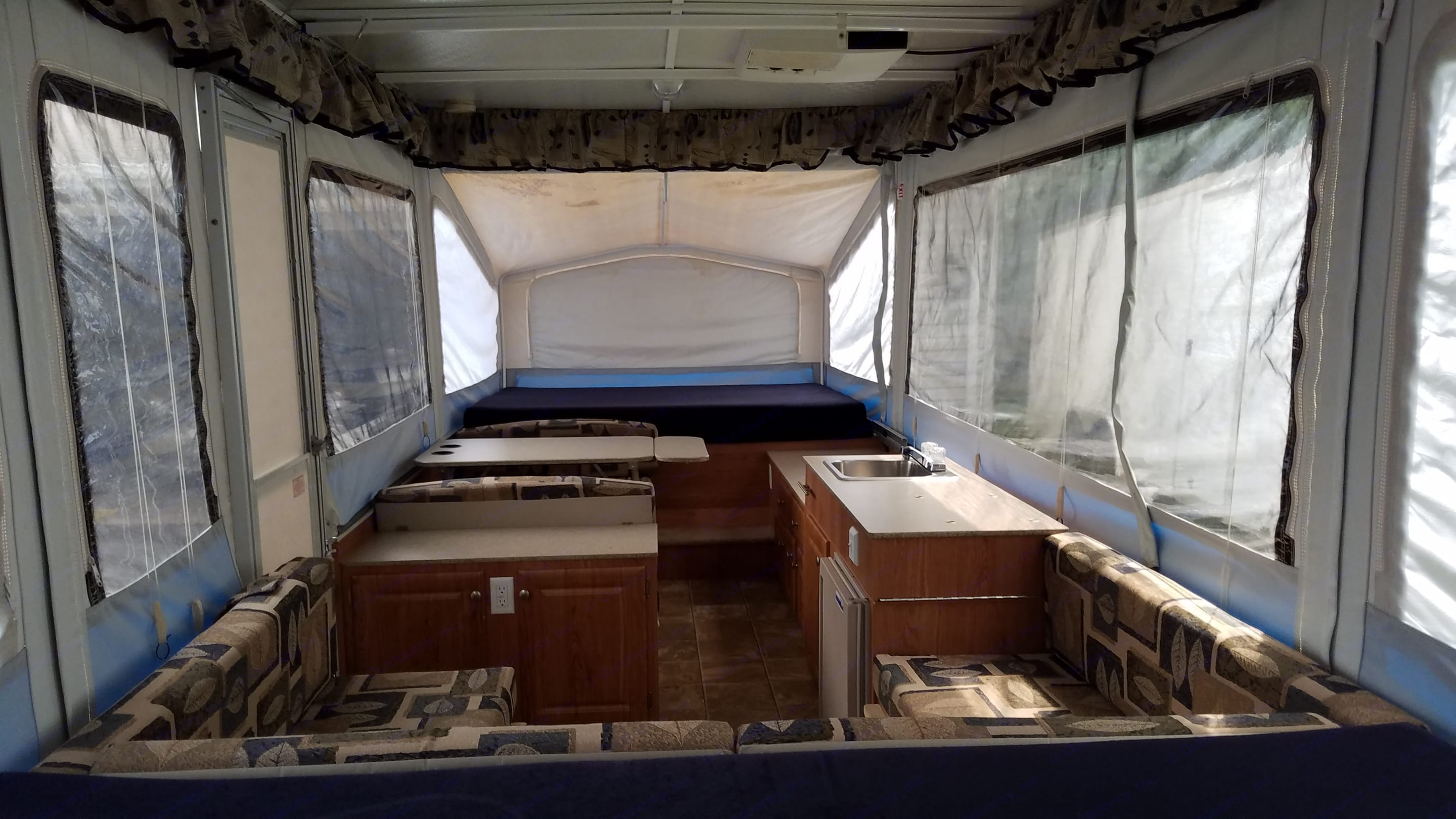Tinted vinyl windows add privacy & shade. Blackout curtains come down allowing you to get it to be pretty dark inside during the day.. Jayco Baja 2008
