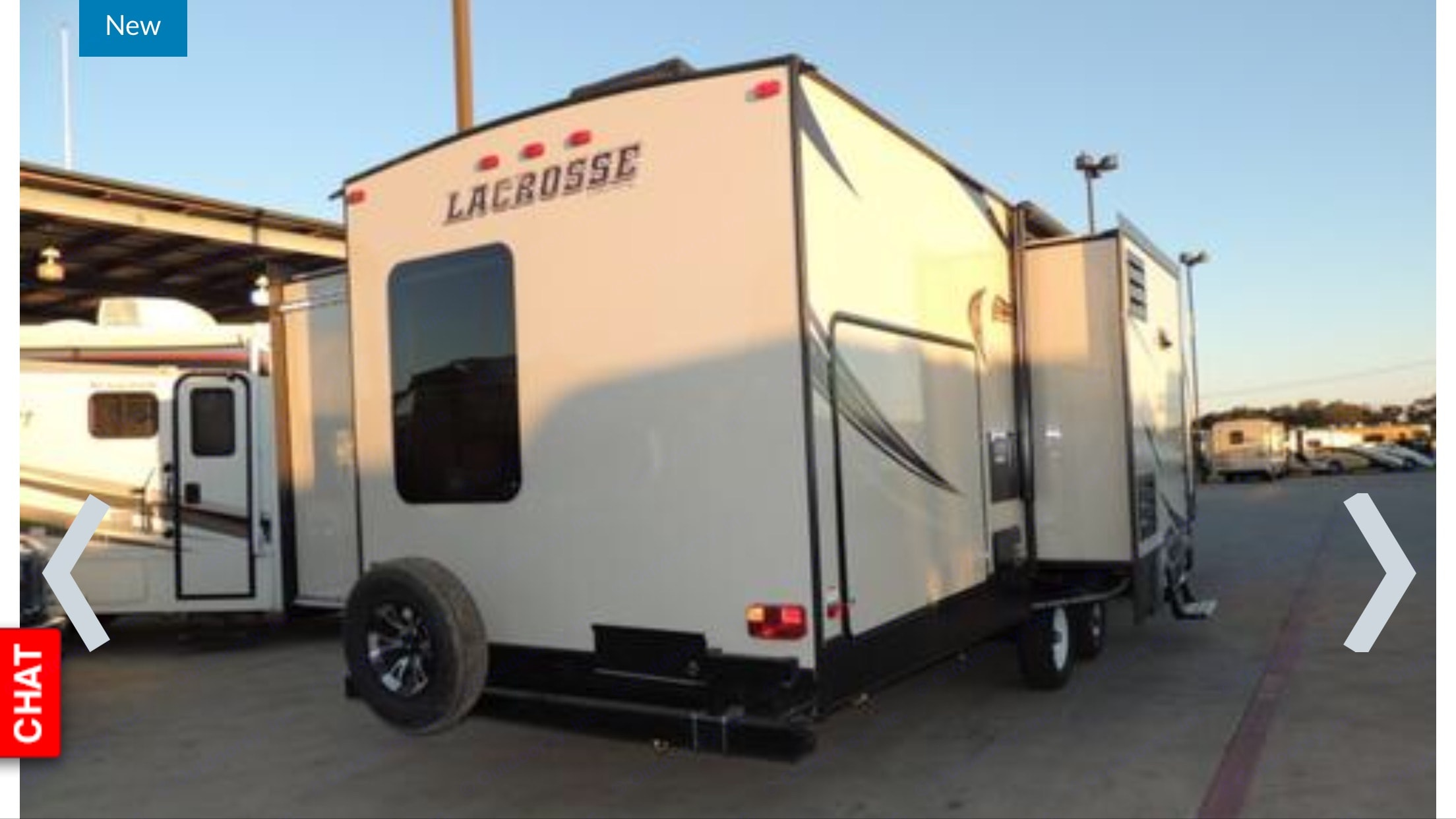 Rear of trailer with the kitchen slide out. Prime Time Lacrosse 2017