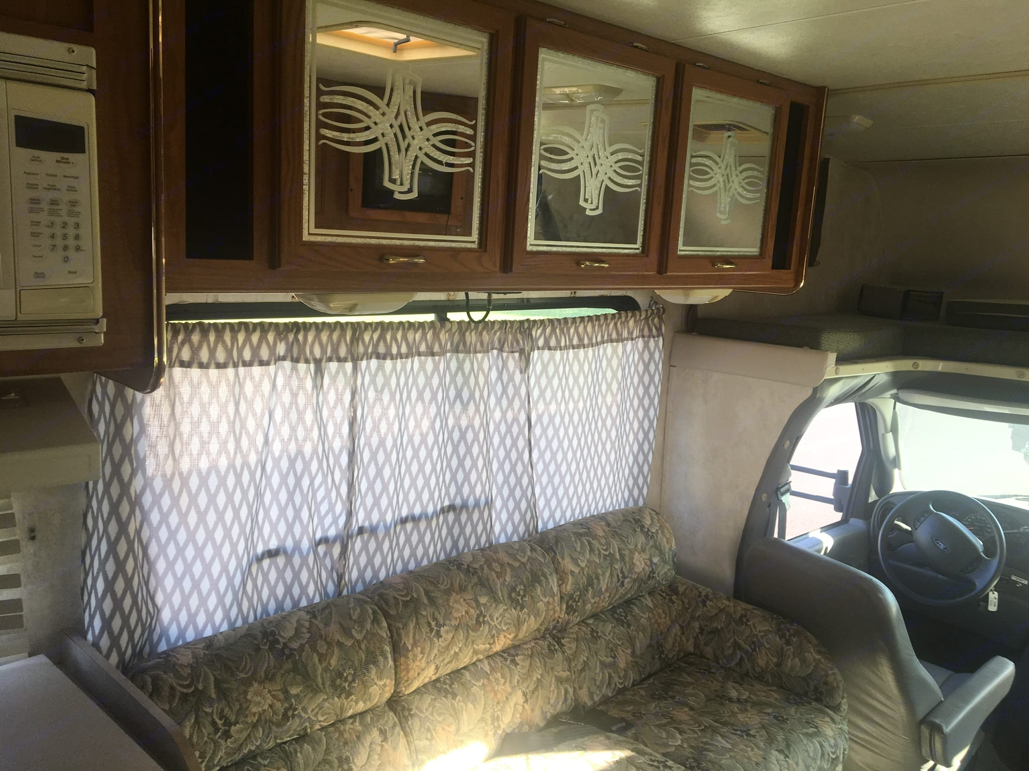 The couch let's out into a bed for added sleep space. . Coachmen E450 Ford 2004