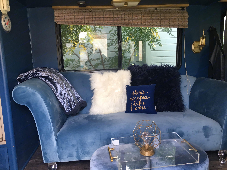 Beautiful blue velvet sofa seats two.. Fleetwood Bounder 1996