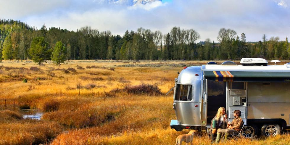 The unit in its natural setting, awning fully out with Badlands National Park colour scheme.. Airstream Pendleton Limited Edition 2016