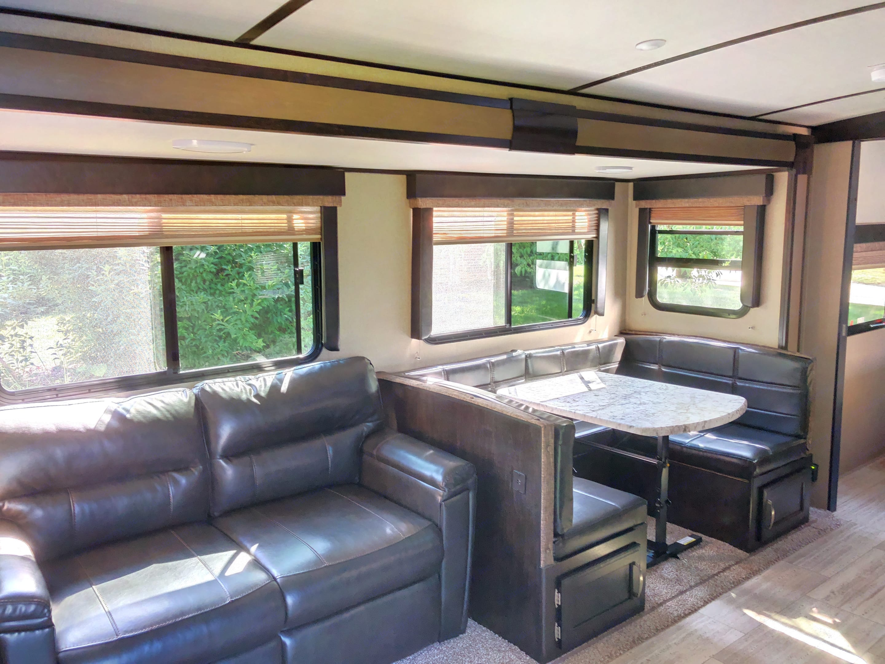 Comfy couch folds out into full size bed and u shaped dinette gives you additional sleeping as well. Grand Design 2800BH 2018