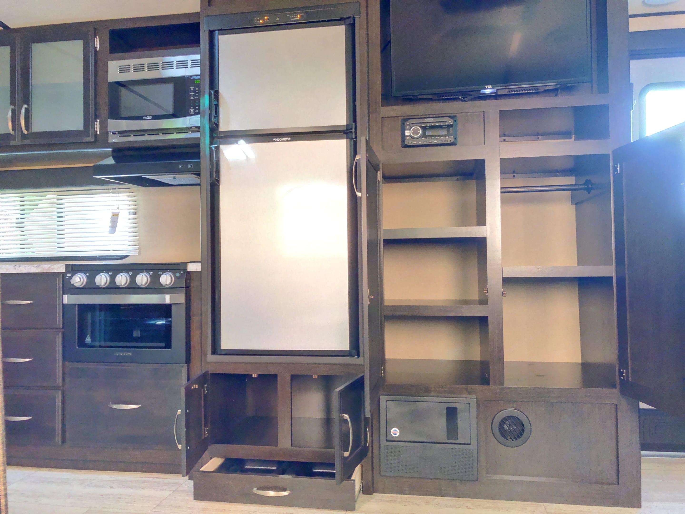 Plenty of cabinet space under a flat screen TV. . Grand Design 2800BH 2018