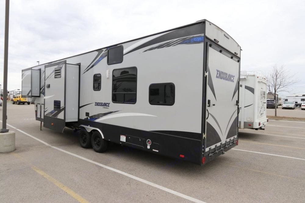 Toy Hauler with 11' Garage and spring loaded ramp make it easy to lower and lift with just one person. . Dutchmen Endurance 2018