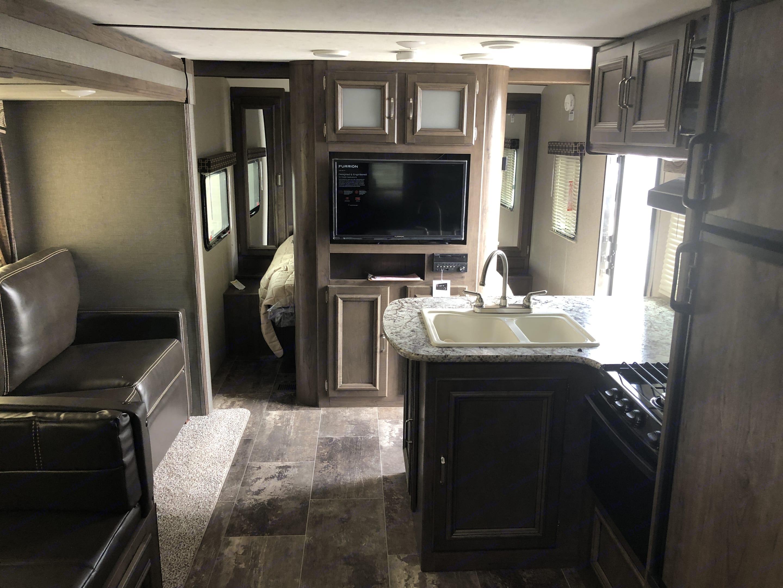 Interior looking from the bunks. Keystone Passport 2018