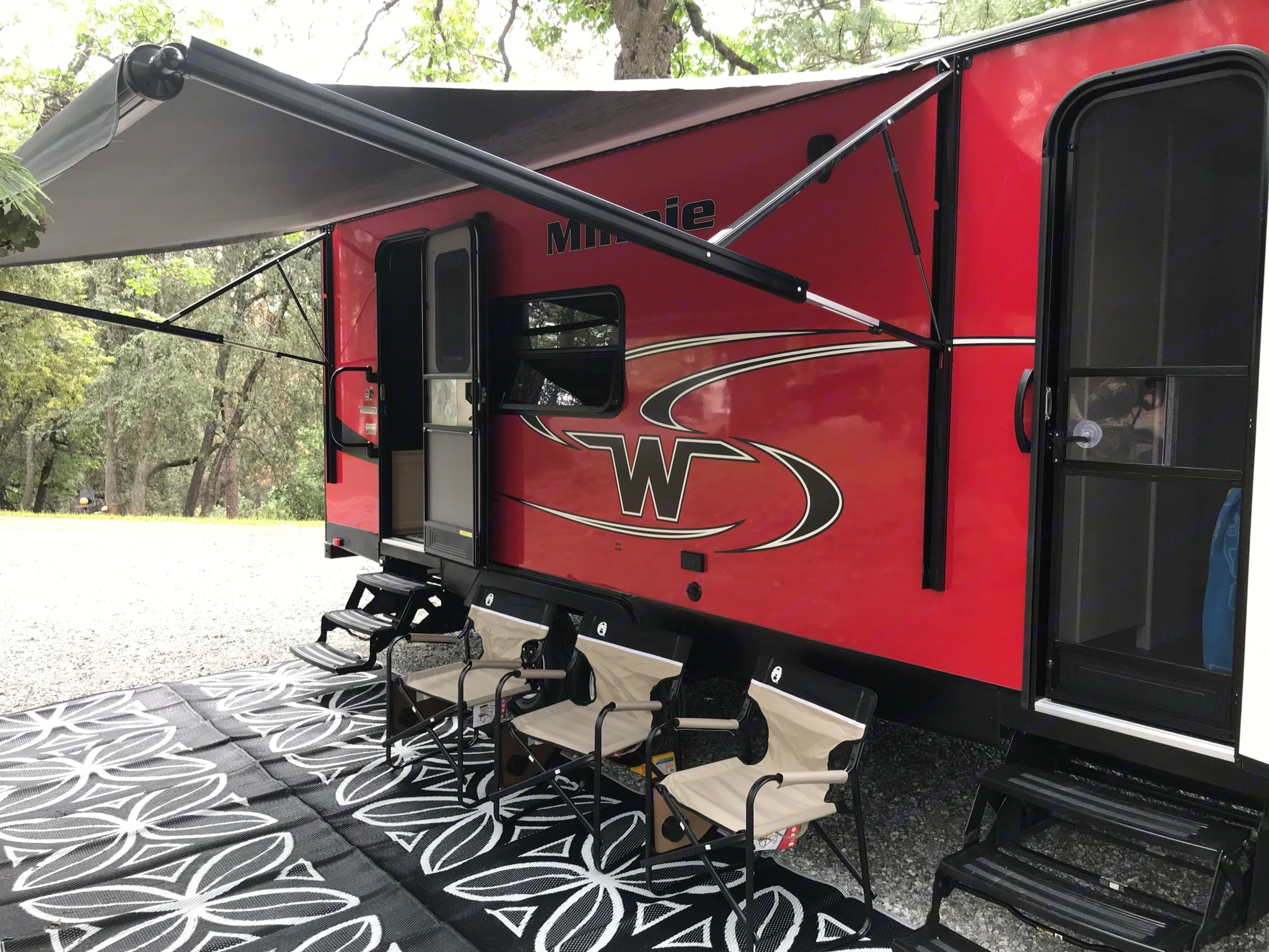 Outside living space featuring full size awning and outdoor rug.. Winnebago Minnie 2018