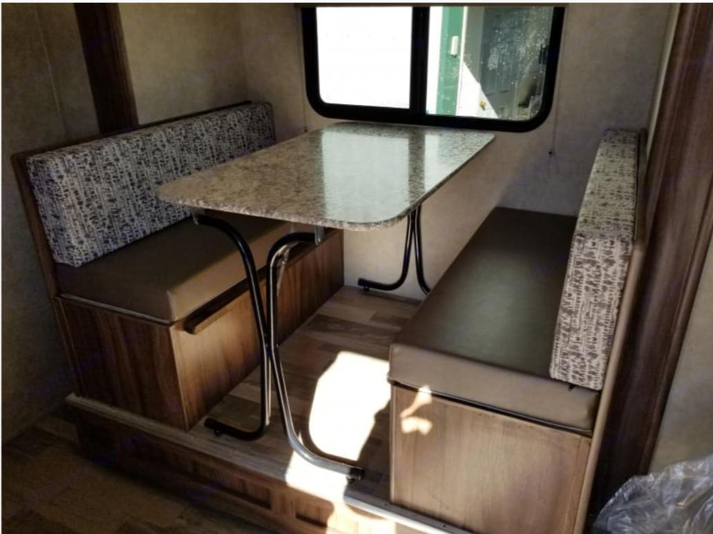 Table converts into bed with storage underneath!. Coachmen Viking 2018