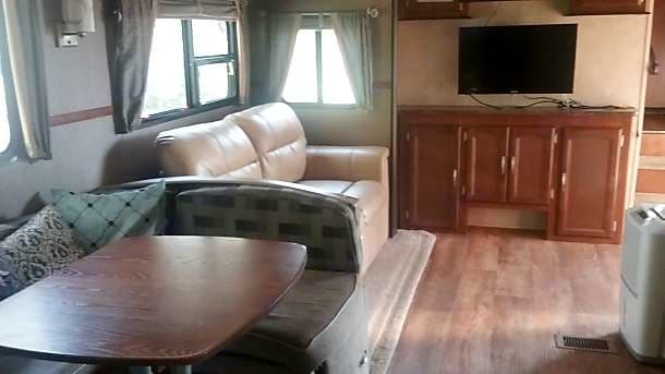 Dinette couch bed and entertainment center. Forest River Heritage Glen Lite 2015