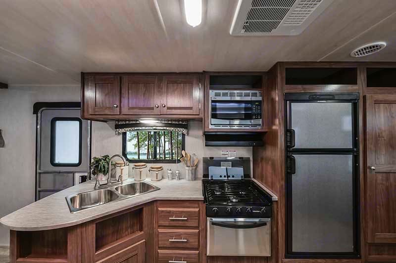 Main entry door and kitchen with pantry. . Heartland Prowler Lynx 2019