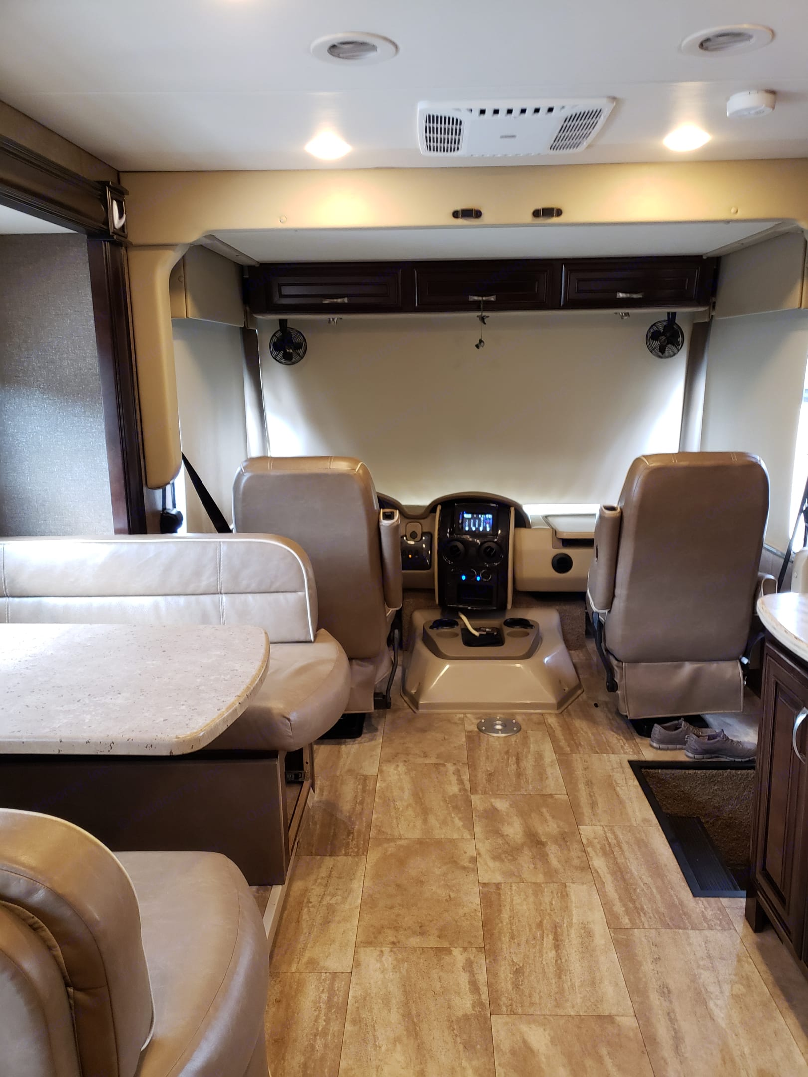View from middle to front, dining booth on side.  Windshield has electrical shade for your privacy and comfort while parked.  Shades also come down on side windows.. Thor Motor Coach Challenger 2017