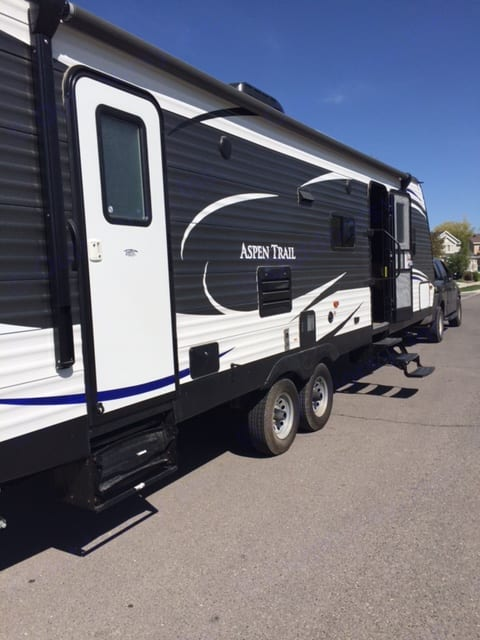 Outside of trailer. Bathroom has a door so its easier to keep kids from running through the trailer to wash hands or go to the bathroom:) . Dutchmen Aspen Trail 2017