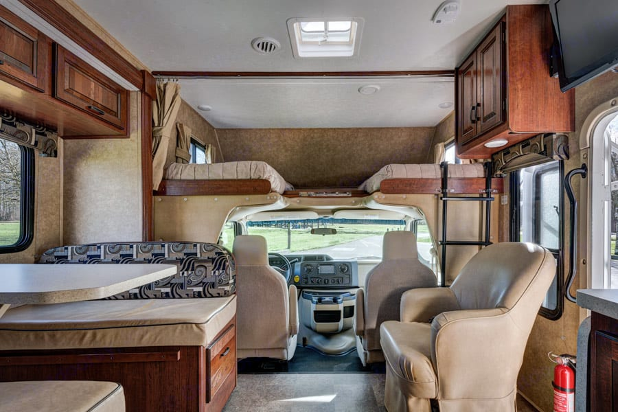 Table seats 4 with 3 seatbelts for travelling plus seatbelt in chair.. Forest River Sunseeker 2012