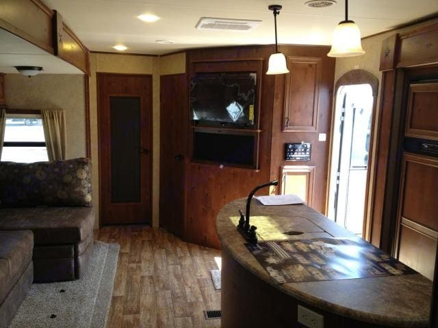 """Rear to front of living room and kitchen.  45"""" flat-screen TV, DVD player, surround sound and stereo system.. Open Range Light 2013"""