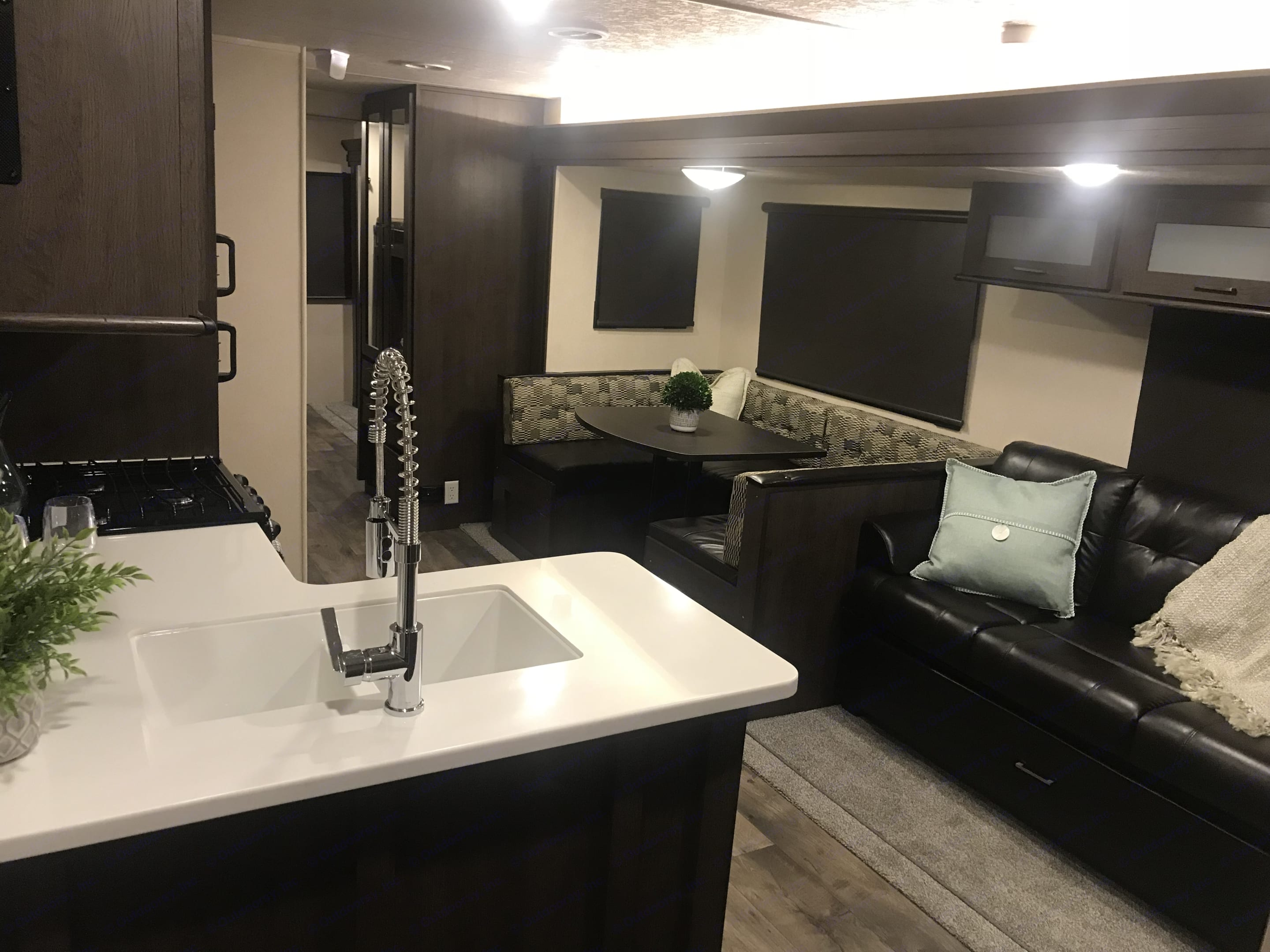 When you step into the RV, you see the couch and dining area. . Forest River Wildwood 32BHDS 2018