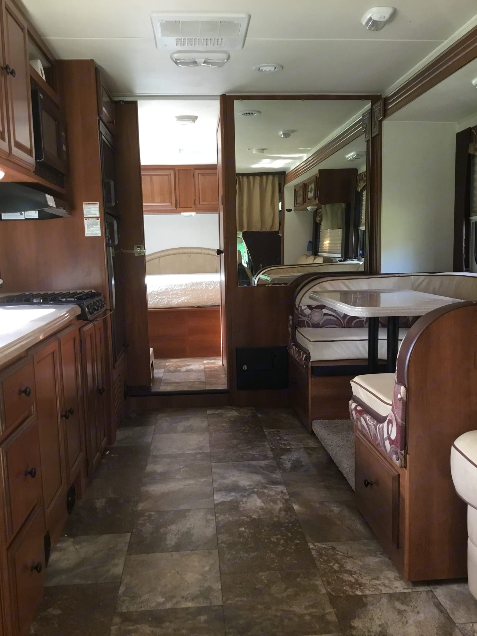 Table to the right converts into another bed. Coachmen Leprechaun 2013