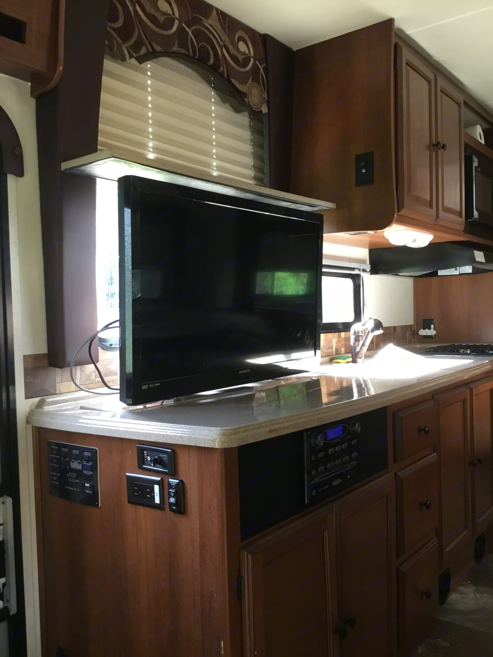 Cool TV rises up from the counter with the push of a button.. Coachmen Leprechaun 2013