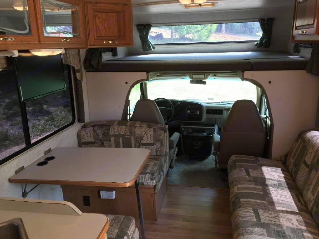 """Dinette turns into a bed comfortable for one.  """"Jack knife"""" sofa easily pulls out for a bed, comfortable for 1 or two small people. . Thor Motor Coach Four Winds Majestic 2002"""