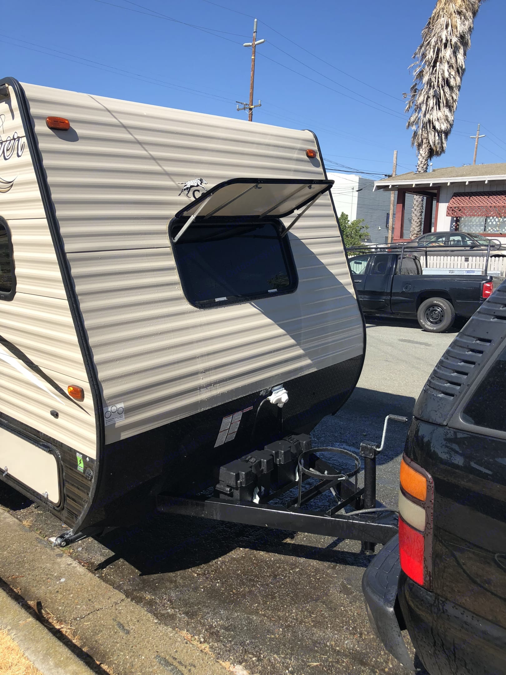 Front of travel trailer with window and window cover.  ( cover is opened ).  This particular window does not open, its mainly used for lighting. Coachmen Clipper 2017