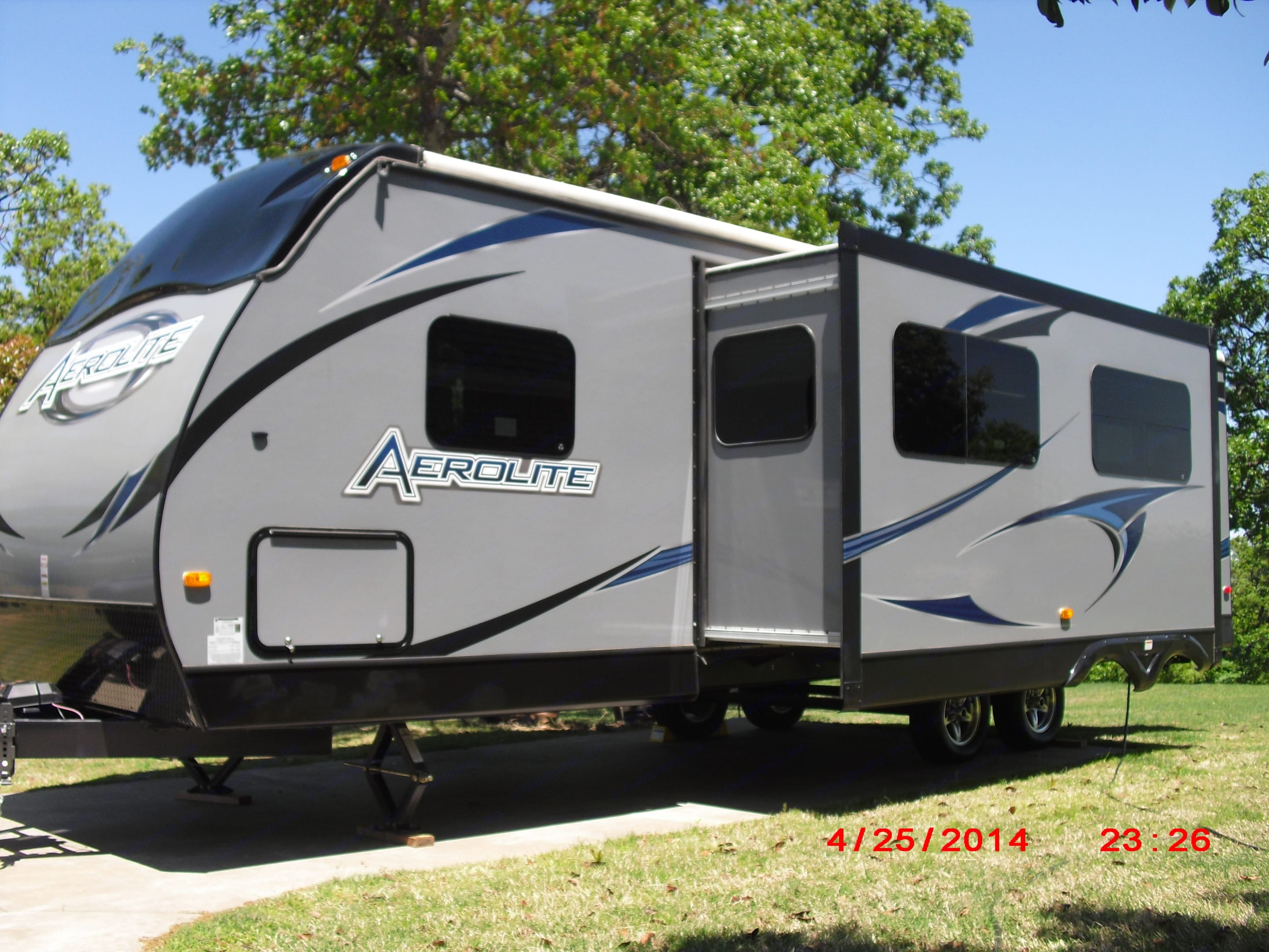 Drivers Side, with slide-out and pass through storage.. Aerolite Travel Trailer 2013