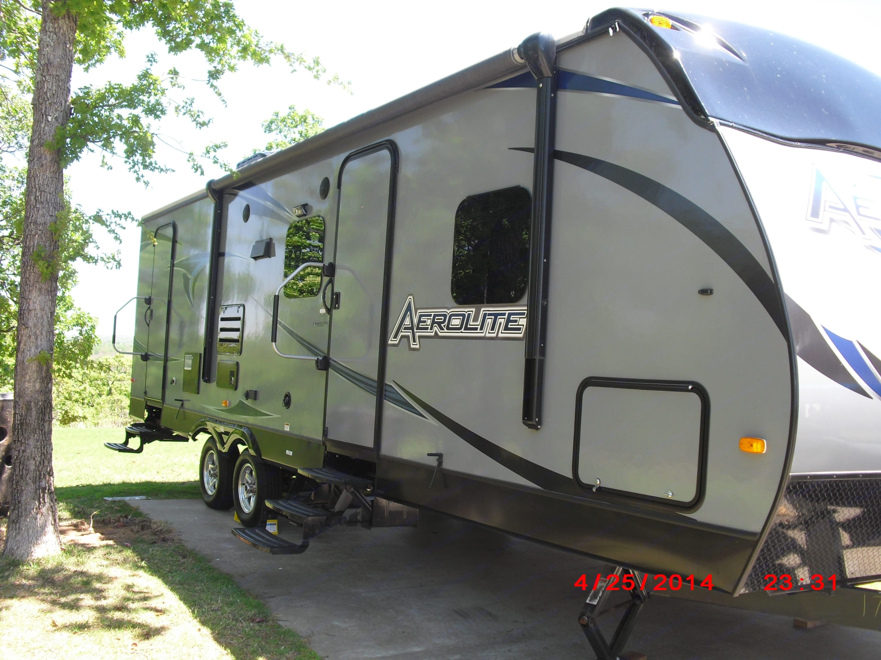 Passenger side.  dual entry.  Outside entry to bathroom.  Extra large handles for easy entry.. Aerolite Travel Trailer 2013