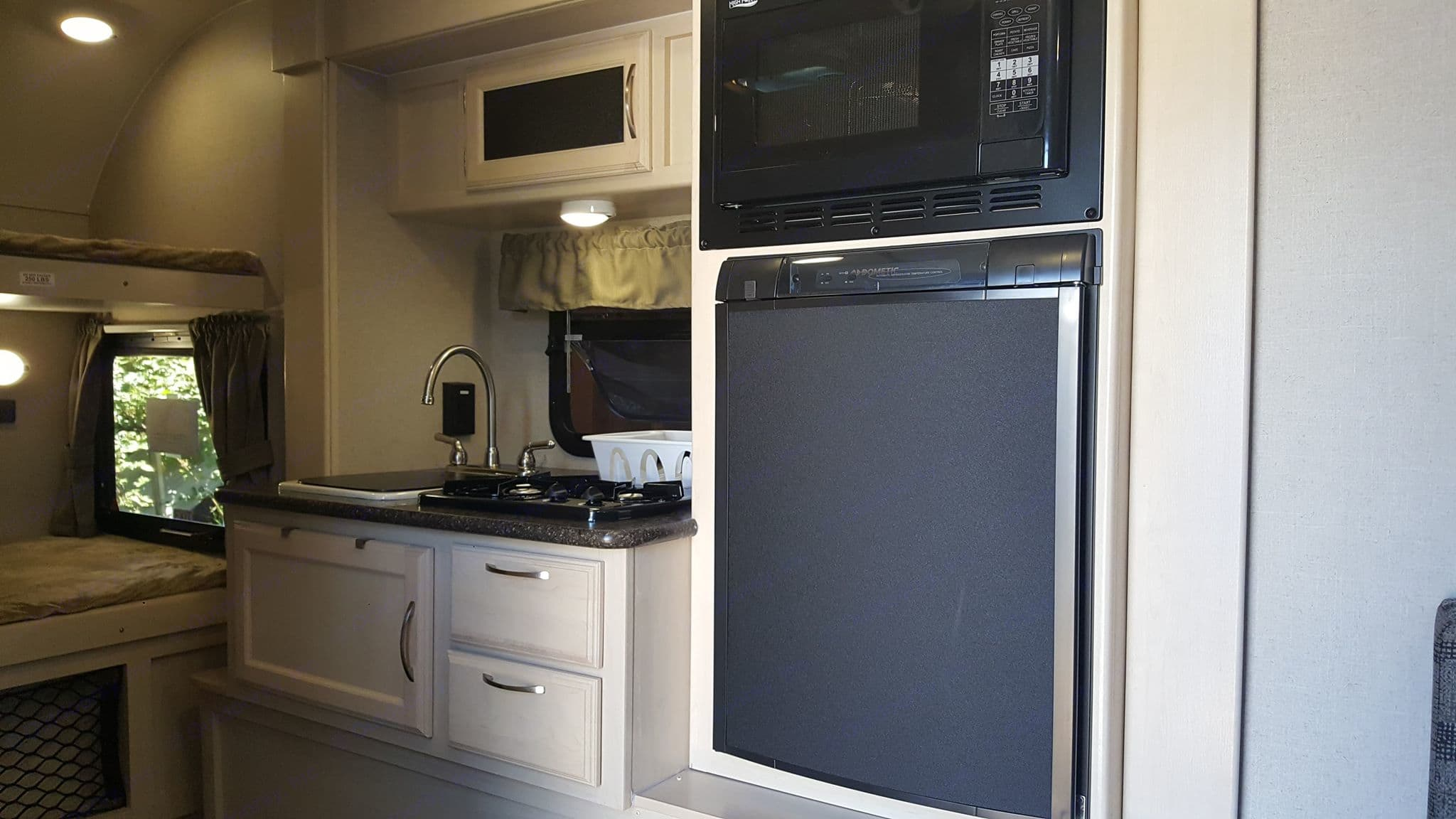 Inside Kitchen. Filled with basic cooking utensils and cleaning supplies. . Winnebago Other 2018