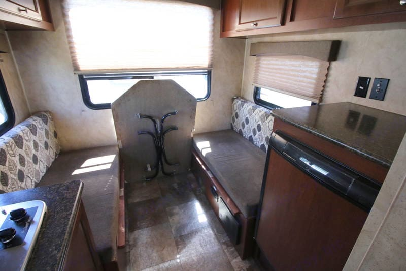 Rear dining area with convertible bed for additional sleeping space!. Coachmen Clipper 2015