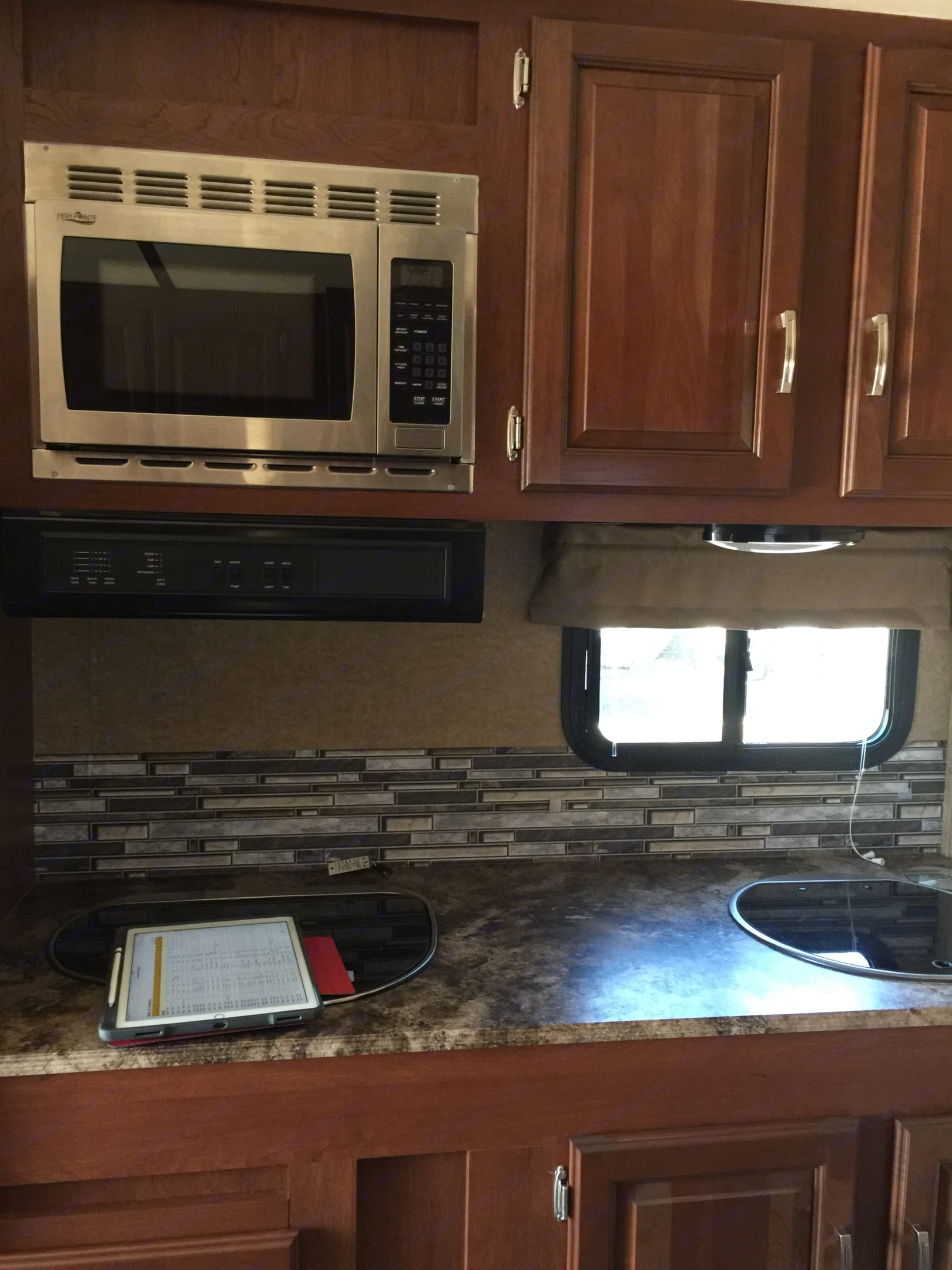 2 burner stove , microwave  & sink . Forest River Work And Play 2014