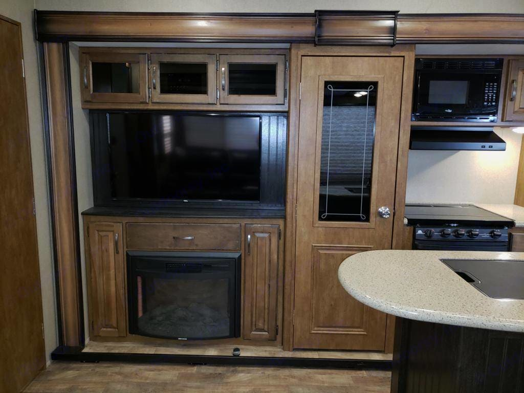 Entertainment center with fireplace . Grand Design Reflection 2014