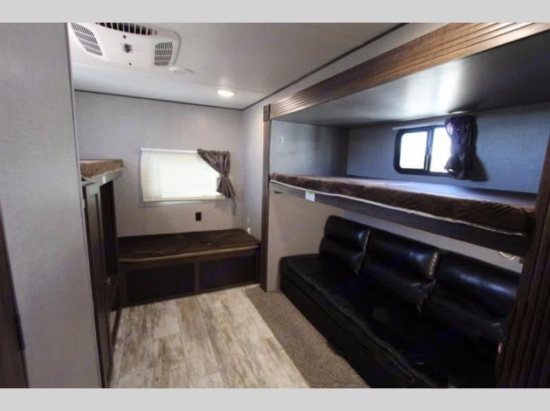 Back Bedroom w\ 3 bunks & a jack-knife couch. Crossroads Longhorn 2018
